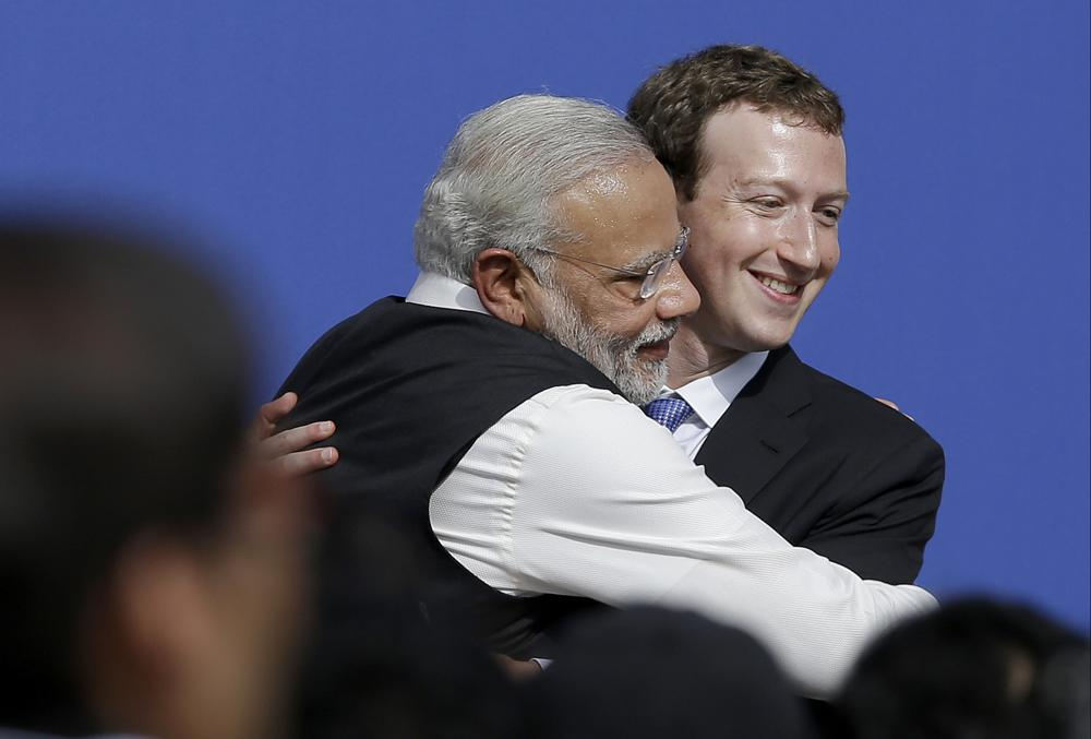 """In this Sept. 27, 2015, file photo, Facebook CEO Mark Zuckerberg, right, hugs Prime Minister of India Narendra Modi at Facebook in Menlo Park, Calif. Officials say a sweeping internet law, announced in February, that puts digital platforms like Twitter and Facebook under direct government oversight are needed to quell misinformation and hate speech and to give users more power to flag objectionable content. Critics of the law worry it may lead to outright censorship in a country where digital freedoms have been shrinking since Modi took office in 2014, many calling it """"digital authoritarianism."""" Facebook's WhatsApp, which has more than 500 million users in India, has sued the government, saying breaking encryption, which continues for now, would """"severely undermine the privacy of billions of people who communicate digitally."""""""