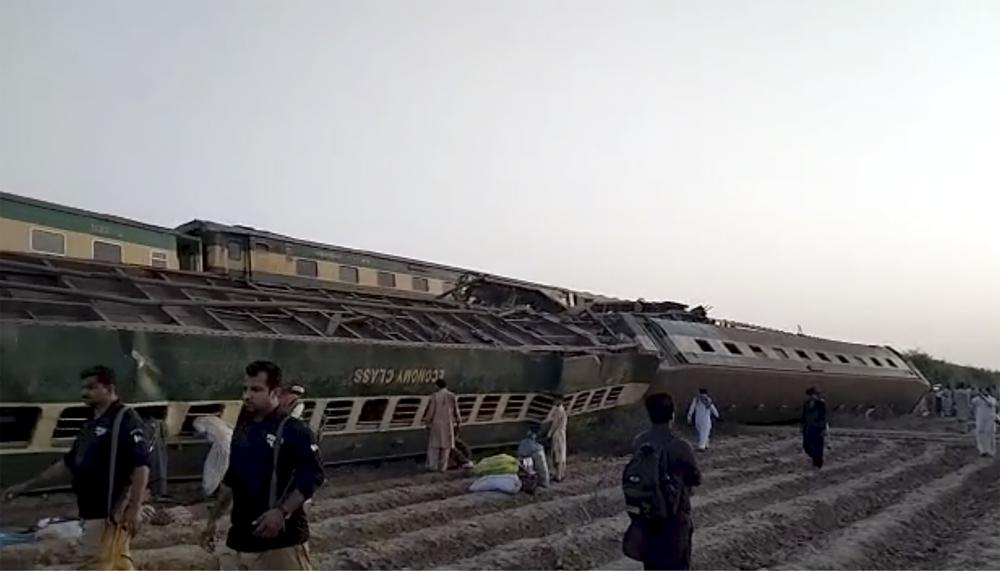 This image from a video, shows a train after a collision in Ghotki, Pakistan Monday, June 7, 2021. Two express trains collided in southern Pakistan early Monday, killing dozens of passengers, authorities said, as rescuers and villagers worked to pull injured people and more bodies from the wreckage. (AP Photo)