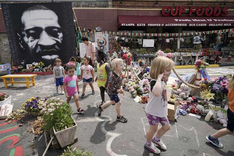 Preschool children visit the site where George Floyd was murdered by then Minneapolis Police officer Derek Chauvin, as the kids took a field trip to the memorial, Thursday, June 24, 2021, in Minneapolis. Chauvin is scheduled to be sentenced on Friday. (AP Photo/Julio Cortez)