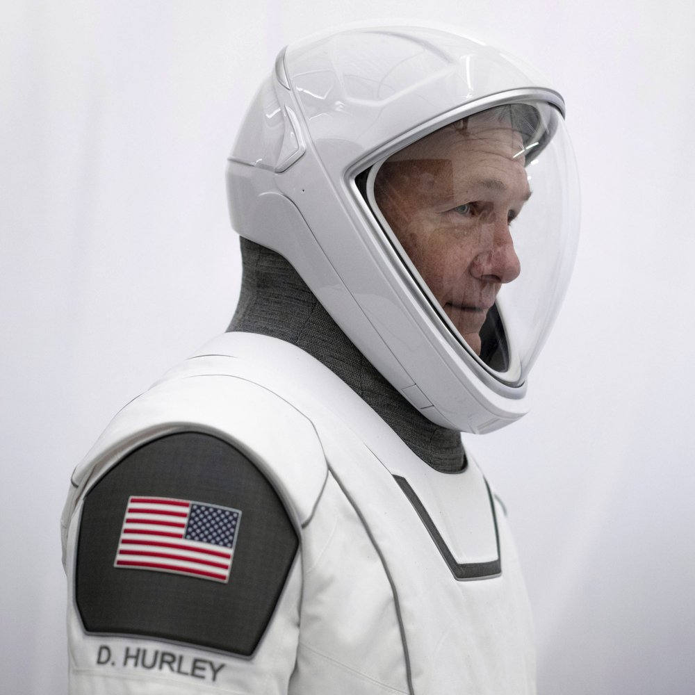 SpaceX's first astronaut launches with style — all white with black trim