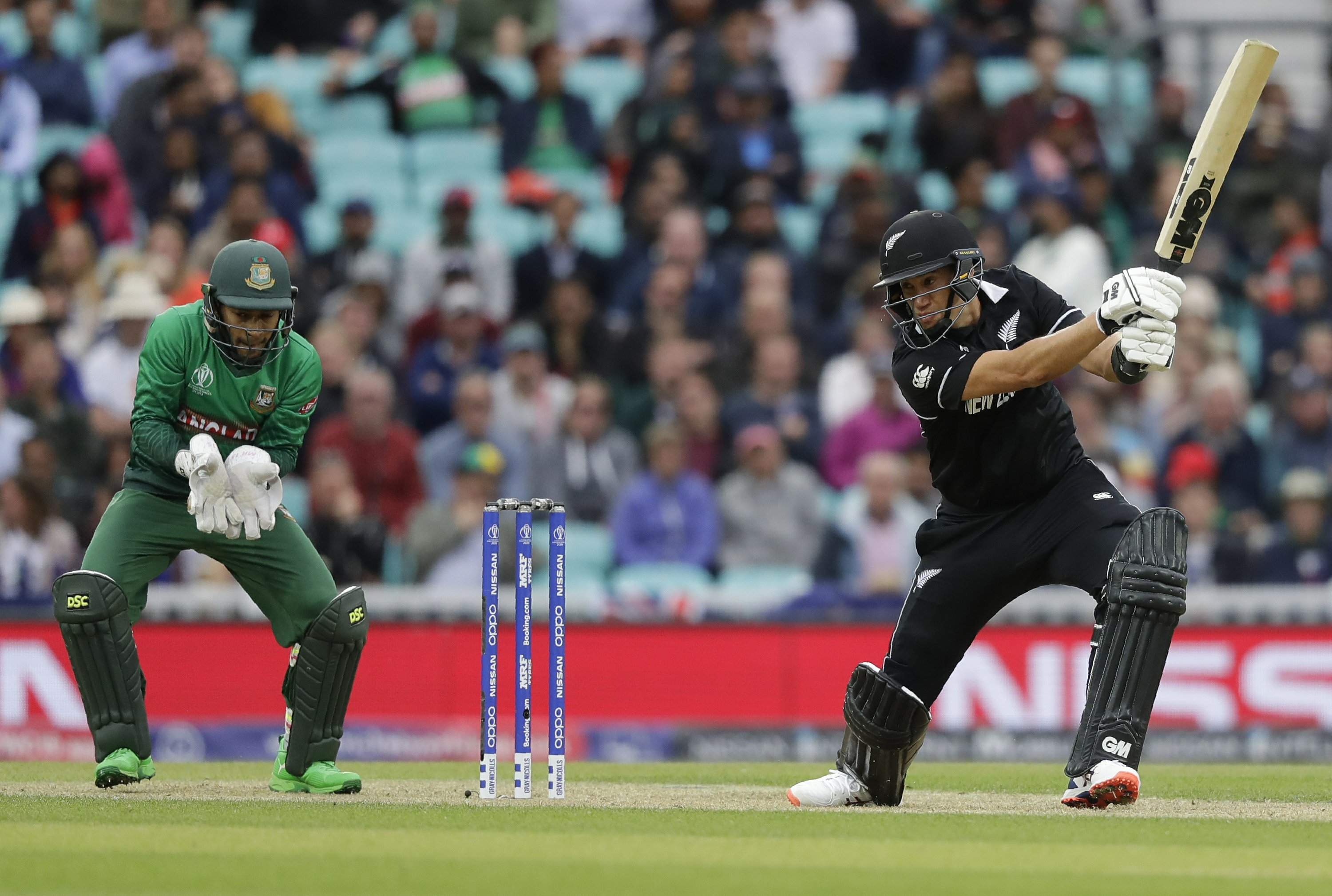 The Latest: NZ beat Bangladesh to top World Cup standings