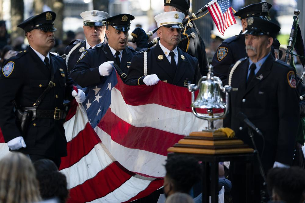 A memorial flag is brought onto the stage during ceremonies to commemorate the 20th anniversary of the Sept. 11 terrorist attacks, Saturday, Sept. 11, 2021, at the National September 11 Memorial & Museum in New York. (AP Photo/John Minchillo)