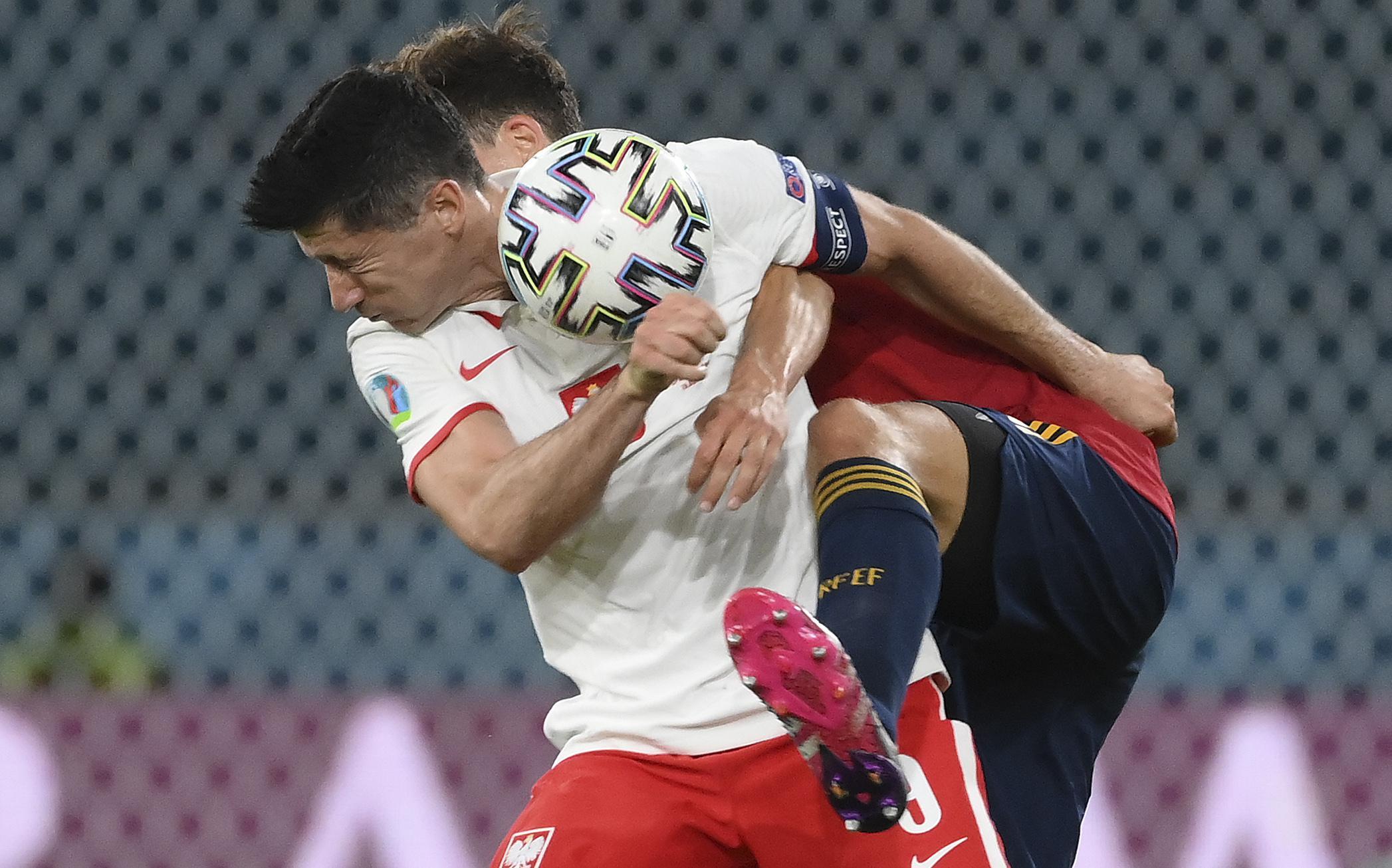 The Latest: Lewandowski gives Poland 1-1 draw against Spain