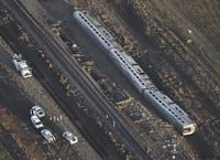 This aerial view taken Sunday, Sept. 26, 2021, shows part of an Amtrak train that derailed in north-central Montana Saturday that killed multiple people and left others hospitalized, officials said. The westbound Empire Builder was en route to Seattle from Chicago, with two locomotives and 10 cars, when it left the tracks about 4 p.m. Saturday. (Larry Mayer/The Billings Gazette via AP)