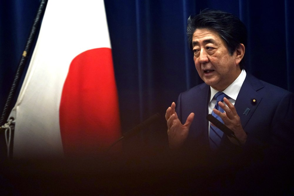 Japanese Prime Minister Shinzo Abe says the coronavirus outbreak in his country has not reached a point that requires him to declare a national emergency