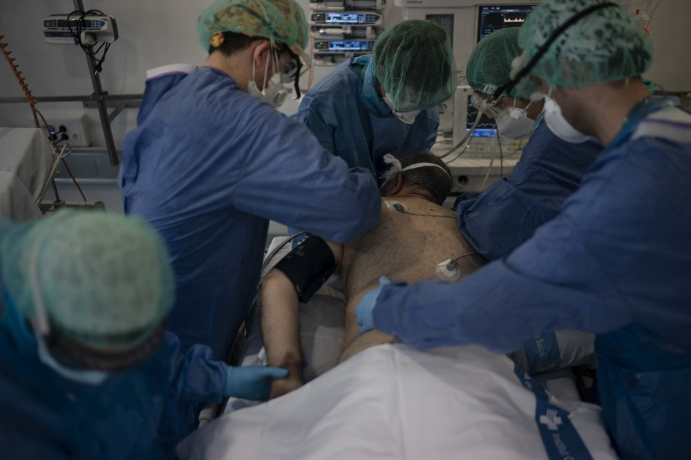 Health care workers in Spain improvise as they continue taking care of those infected by the coronavirus plague