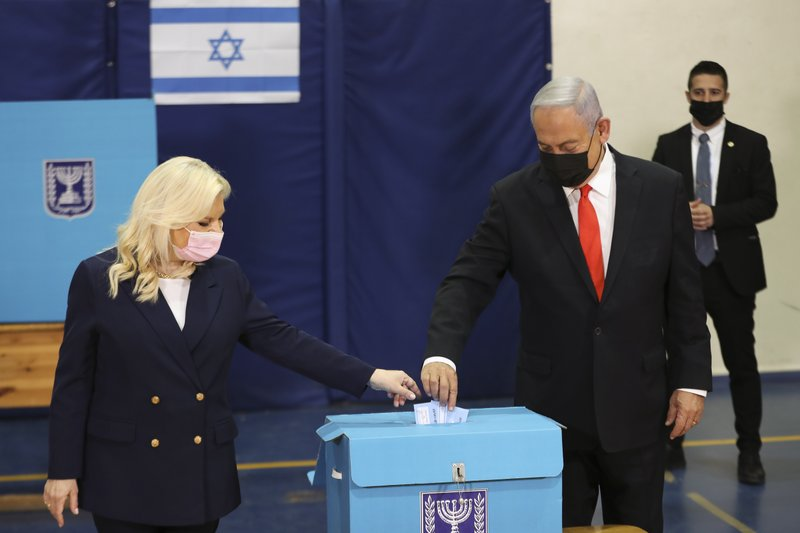 Israeli Prime Minister Benjamin Netanyahu fights for survival as Israel votes again for the fourth time in past two years; Exit polls indicate no clear winner