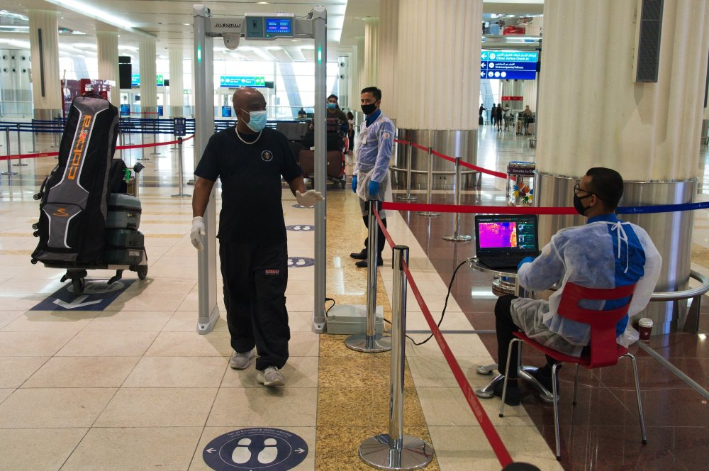 Several countries blame Dubai for virus cases; questions swirl at home