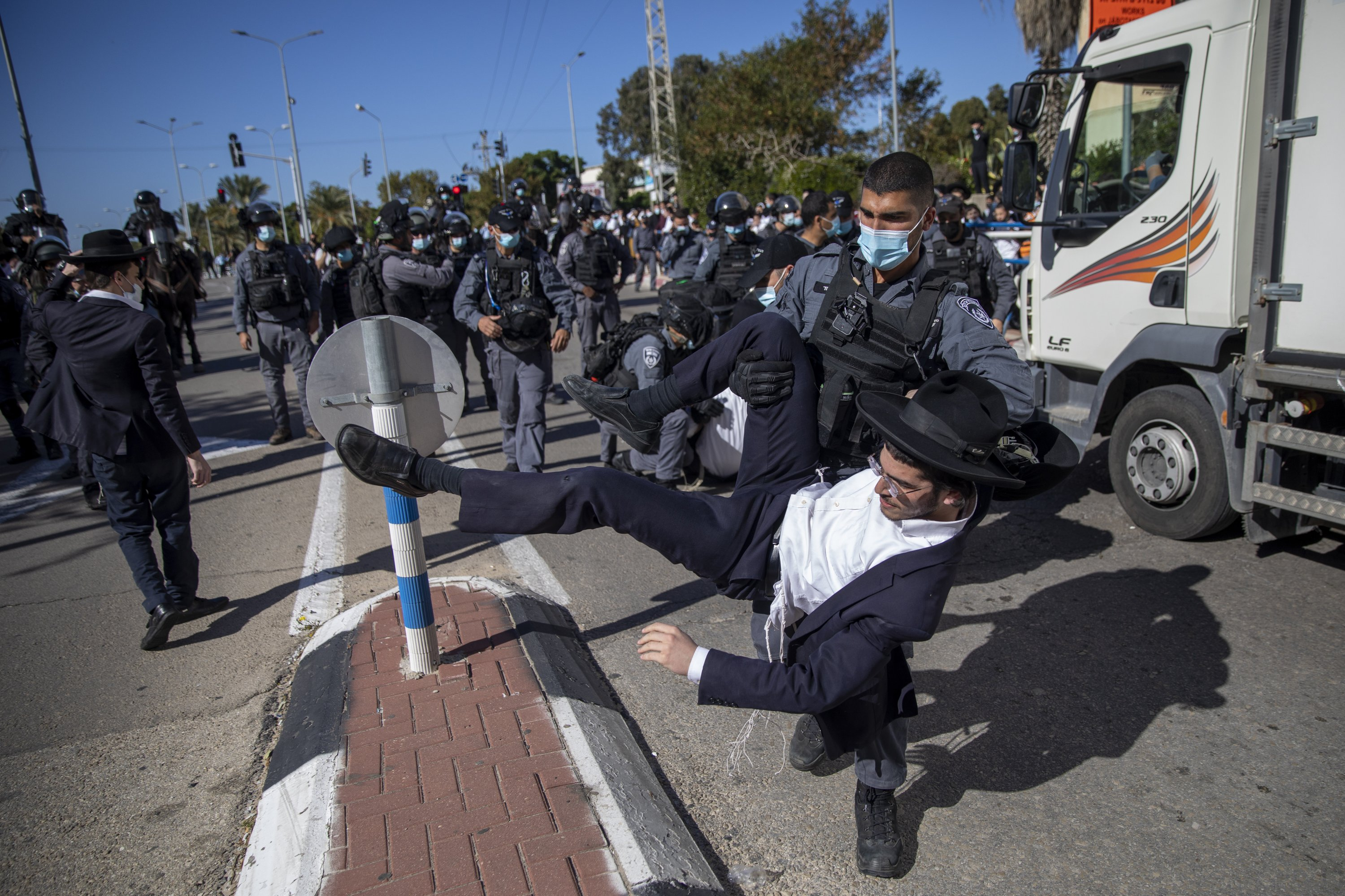 Israel's ultra-Orthodox reject criticism, defy virus rules