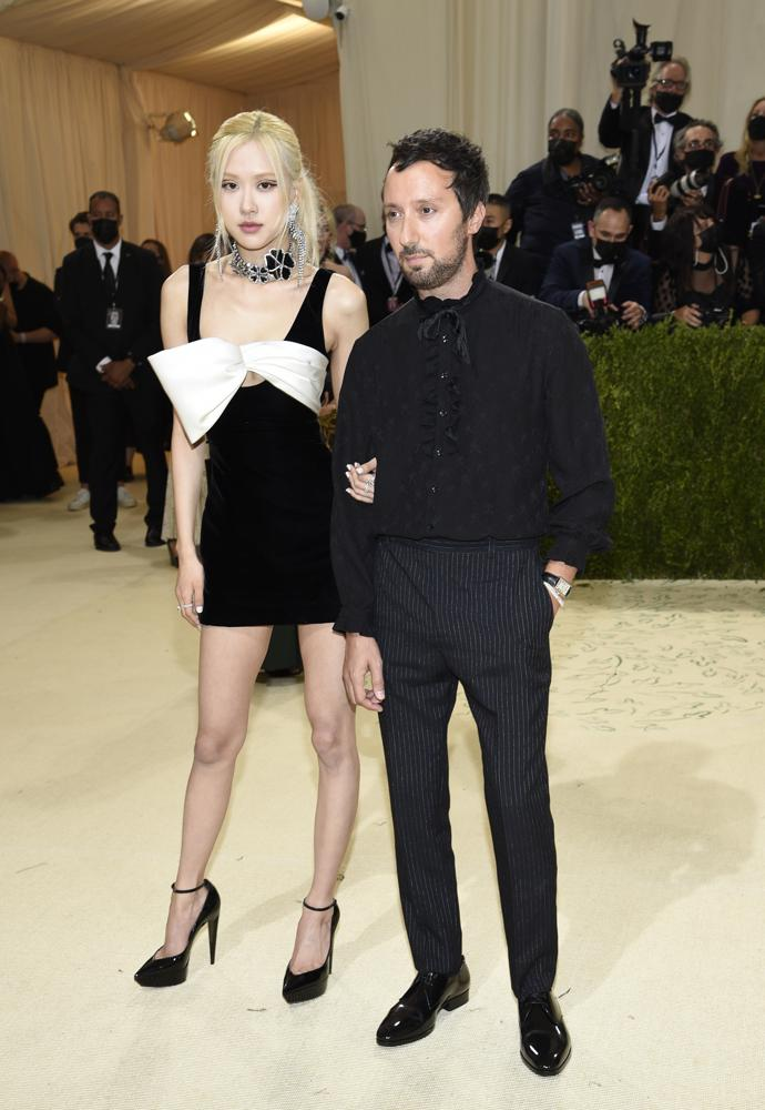 """Rose, left, and Anthony Vaccarello attend The Metropolitan Museum of Art's Costume Institute benefit gala celebrating the opening of the """"In America: A Lexicon of Fashion"""" exhibition on Monday, Sept. 13, 2021, in New York. (Photo by Evan Agostini/Invision/AP)"""