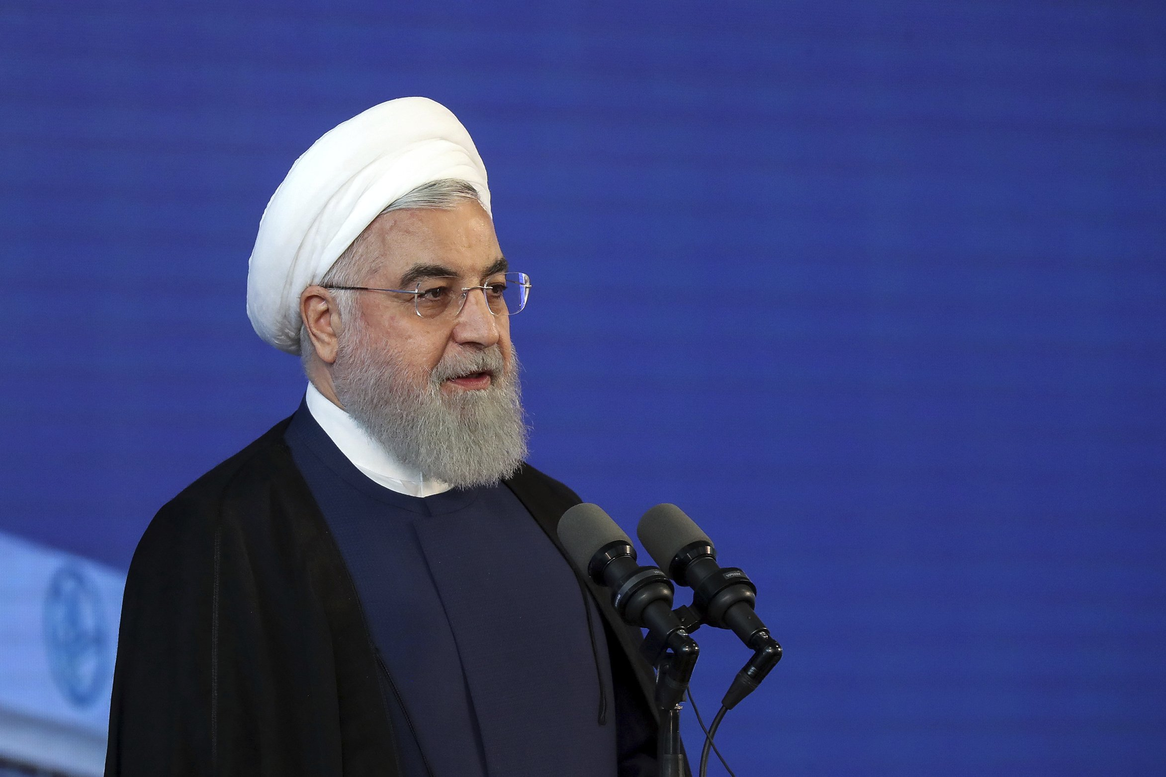The Latest: Iran's Rouhani disparages Trump over sanctions