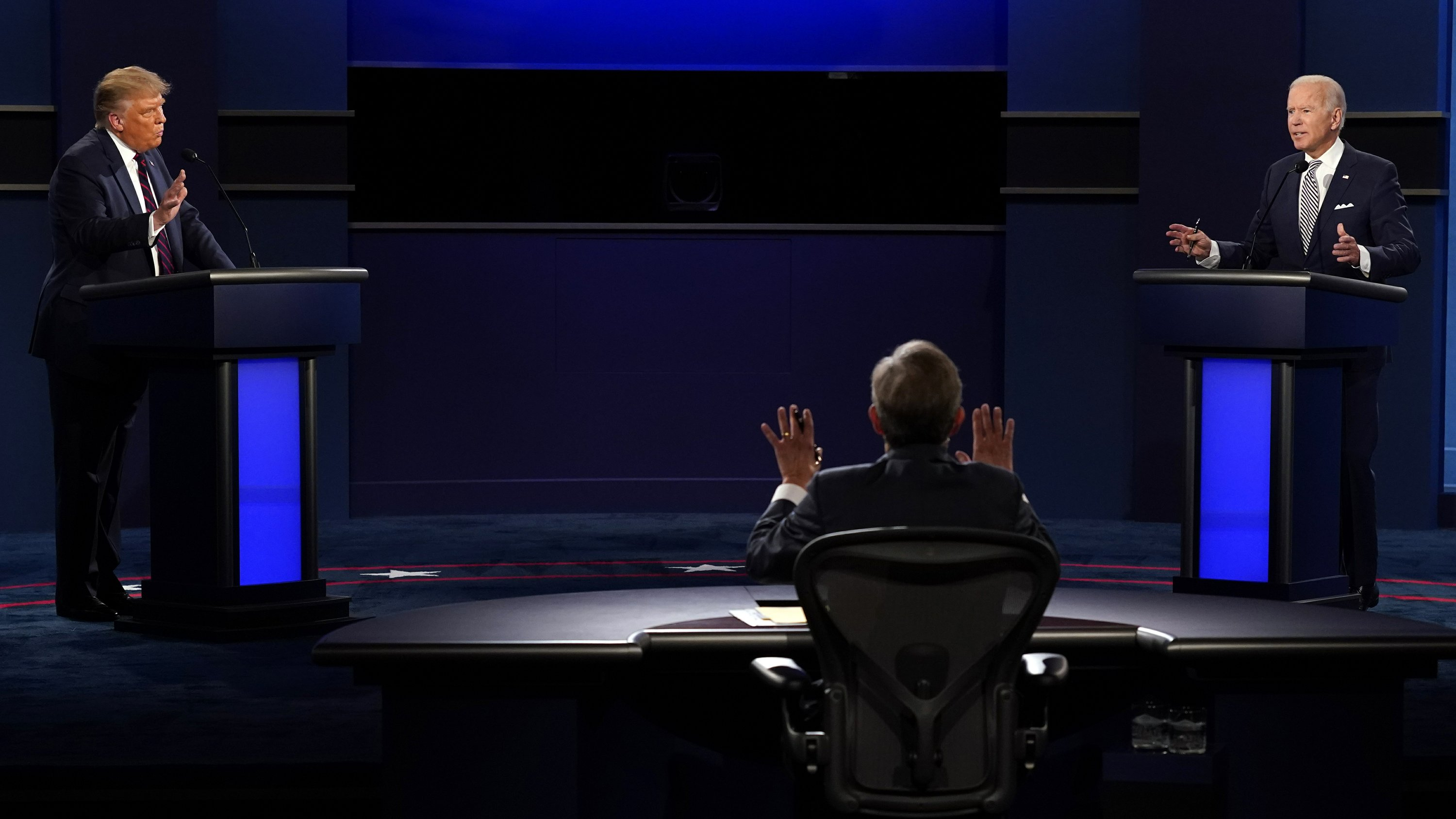 The Latest: Debate commission adopts new rules to mute mics