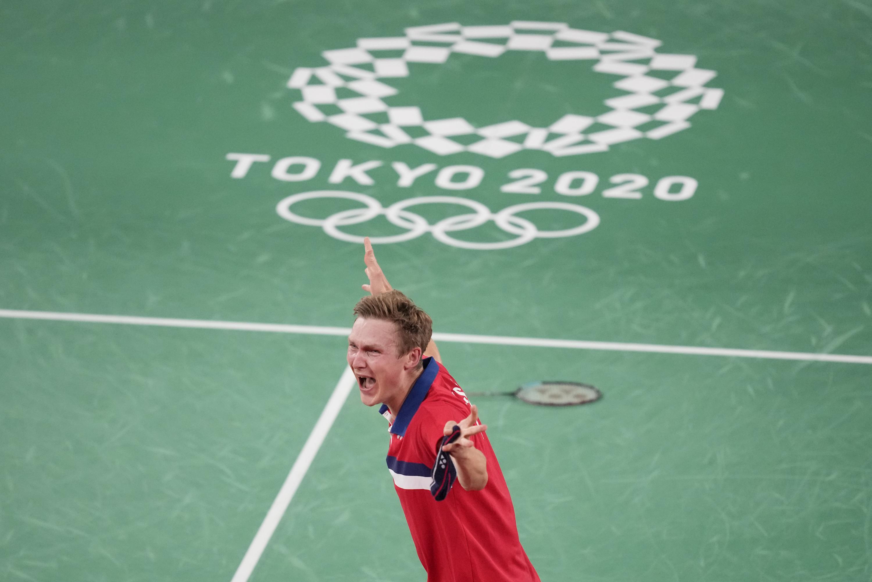 Denmark's Axelsen wins badminton gold over China's Chen - Associated Press
