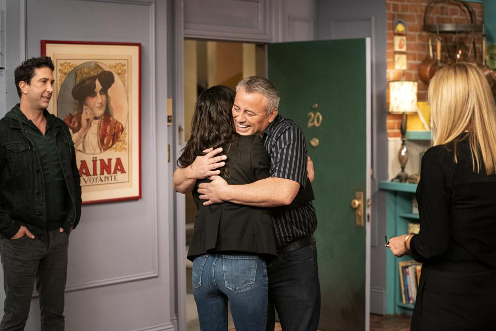 """This image provided by HBO Max shows David Schwimmer, from left, Courteney Cox, Matt LeBlanc and Jennifer Aniston in a scene from the """"Friends"""" reunion special. (Terence Patrick/HBO Max via AP)"""