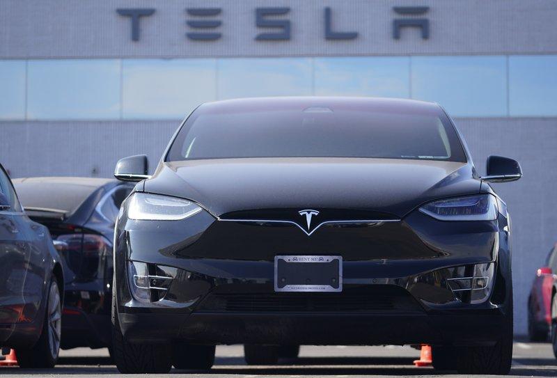 Tesla posts 1st annual profit but misses analysts' estimates