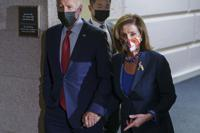In this Oct. 1, 2021 photo, President Joe Biden and Speaker of the House Nancy Pelosi, D-Calif., walk in a basement hallway of the Capitol after meeting with House Democrats, on Capitol Hill in Washington. Divided Democrats struggling to enact President Joe Biden's domestic agenda are confronting one of Congress' cruelest conundrums — your goals may be popular, but that doesn't ensure they'll become law or that voters will reward you.   (AP Photo/J. Scott Applewhite)