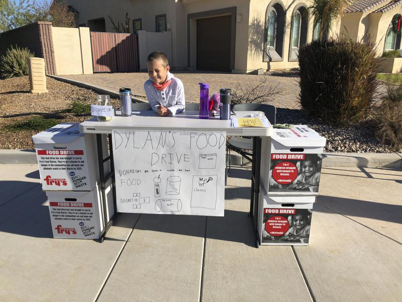 8-year-old Dylan Pfeifer of Arizona holds food drives to help in pandemic