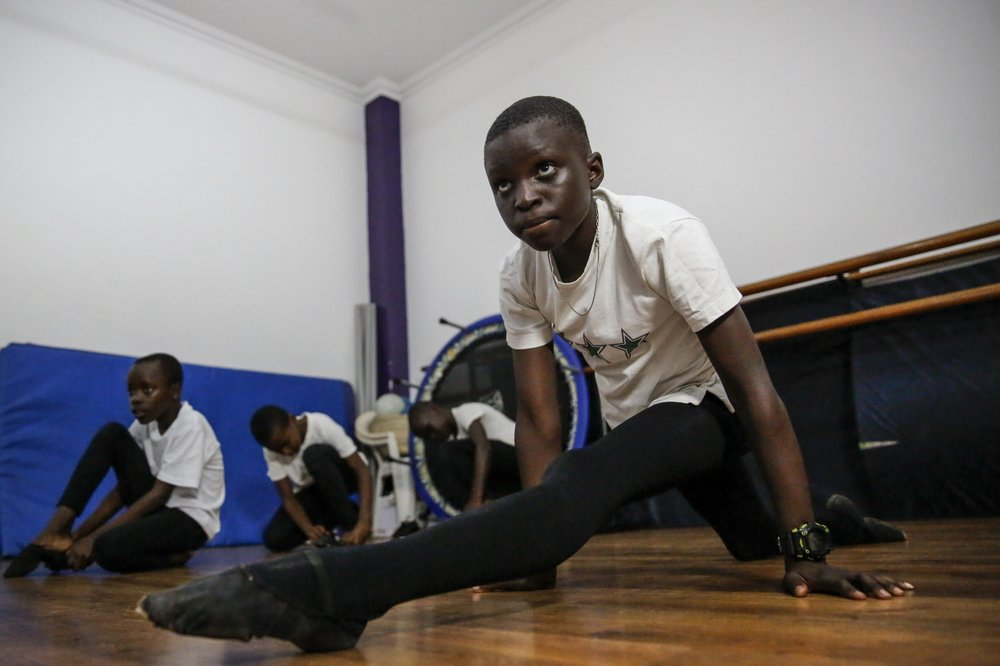 12-year-old ballet student Eugene Ochieng faces huge obstacles to remote learning: no computer, no internet access and very little space to practice, yet he still practices