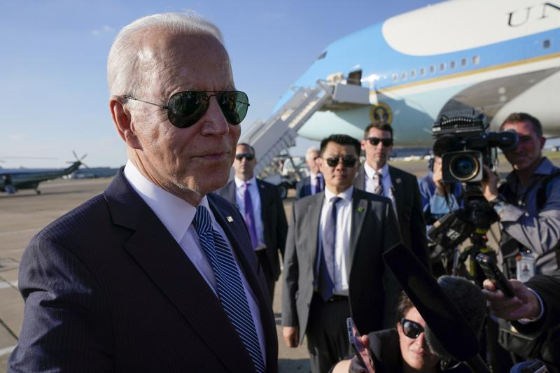 President Joe Biden speaks with reporters before boarding Air Force One at Heathrow Airport in London, Sunday, June 13, 2021. Biden is en route to Brussels to attend the NATO summit. (AP Photo/Patrick Semansky)