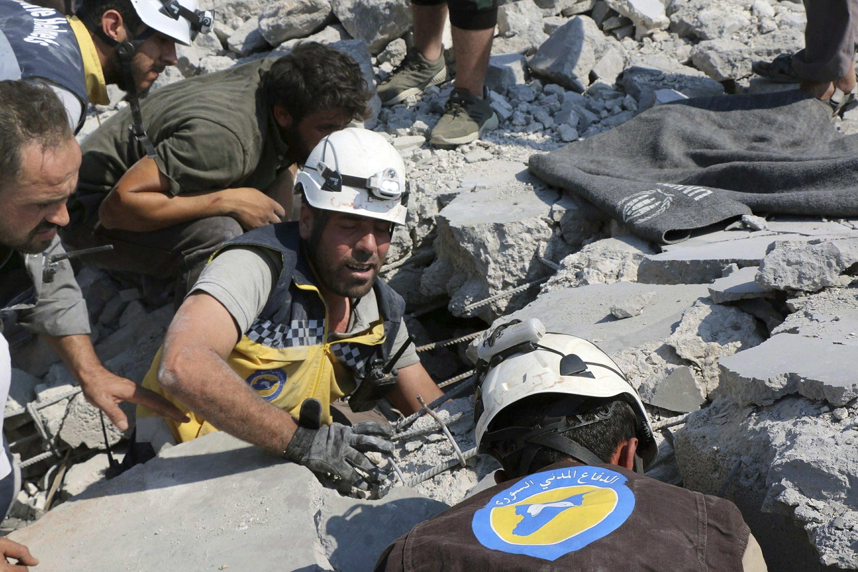 Activists: Airstrikes halt Turkish convoy on road in Syria