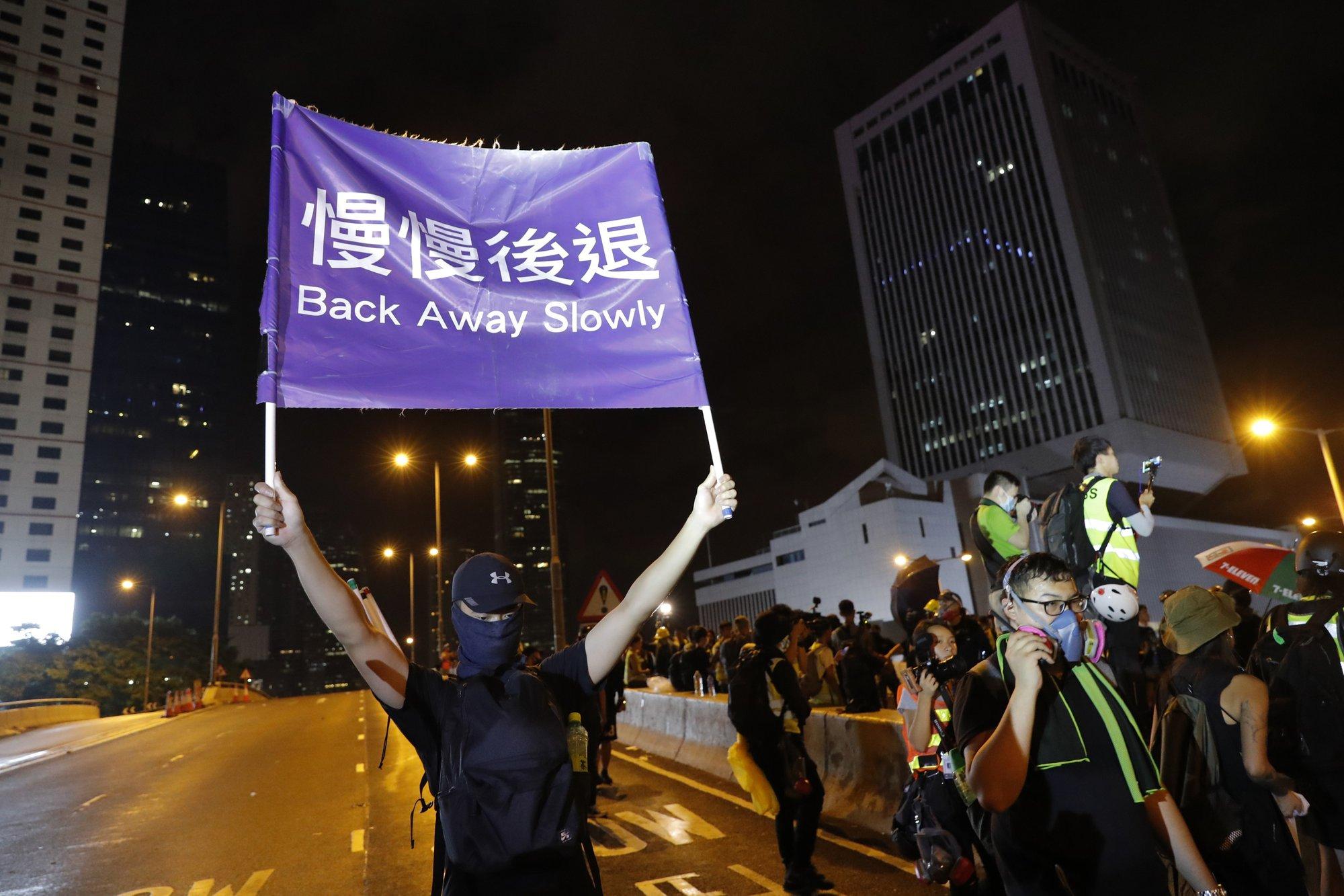 915e4054e1e Police keep low profile at huge, peaceful Hong Kong protest