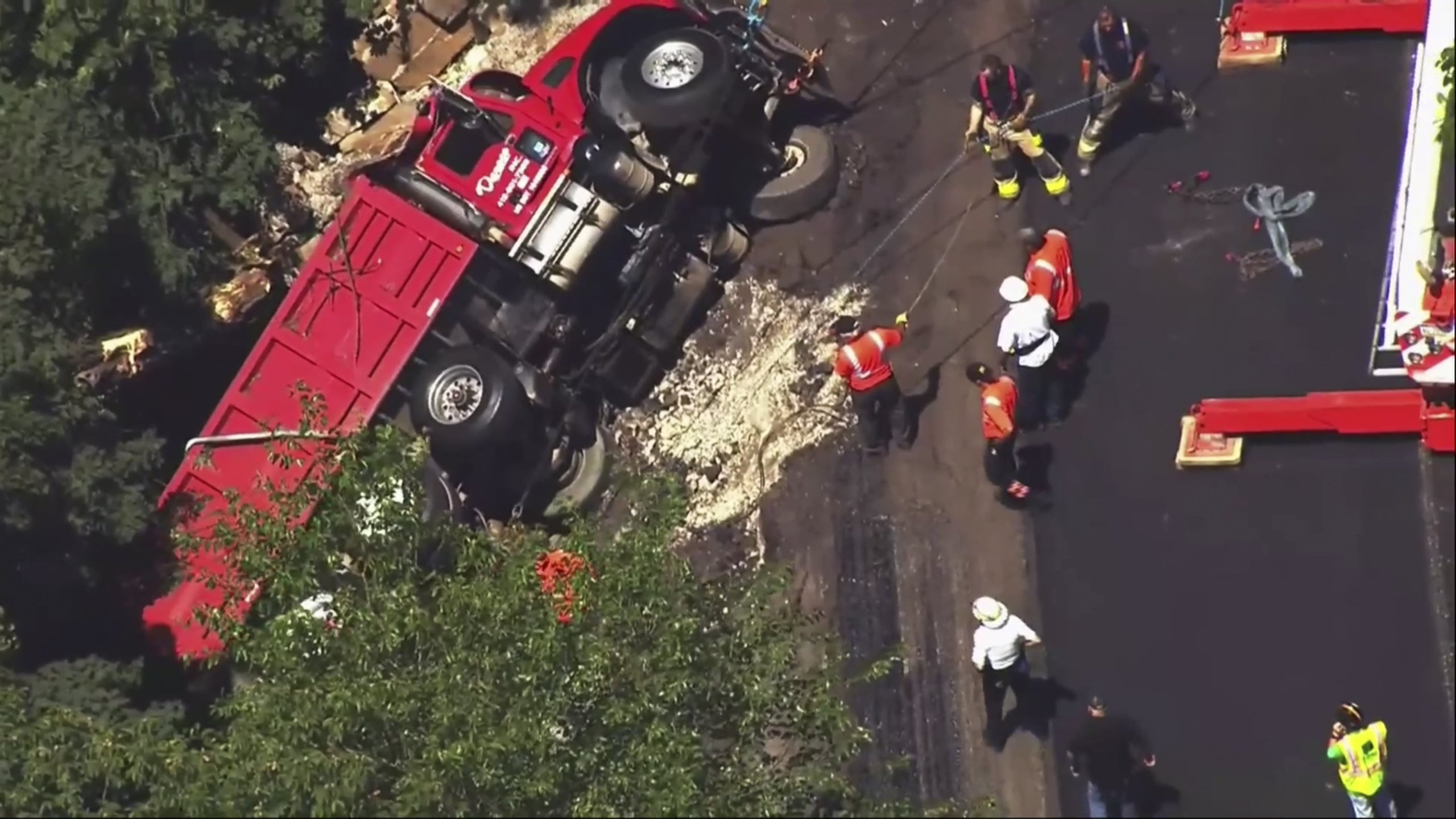 Driver rescued after truck goes down Pittsburgh hillside