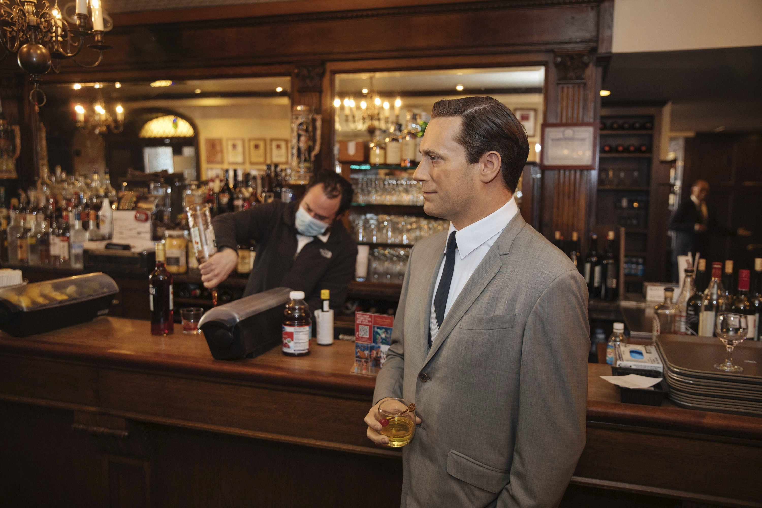 NYC steakhouse stunt: A wax Don Draper hanging at the bar - Associated Press