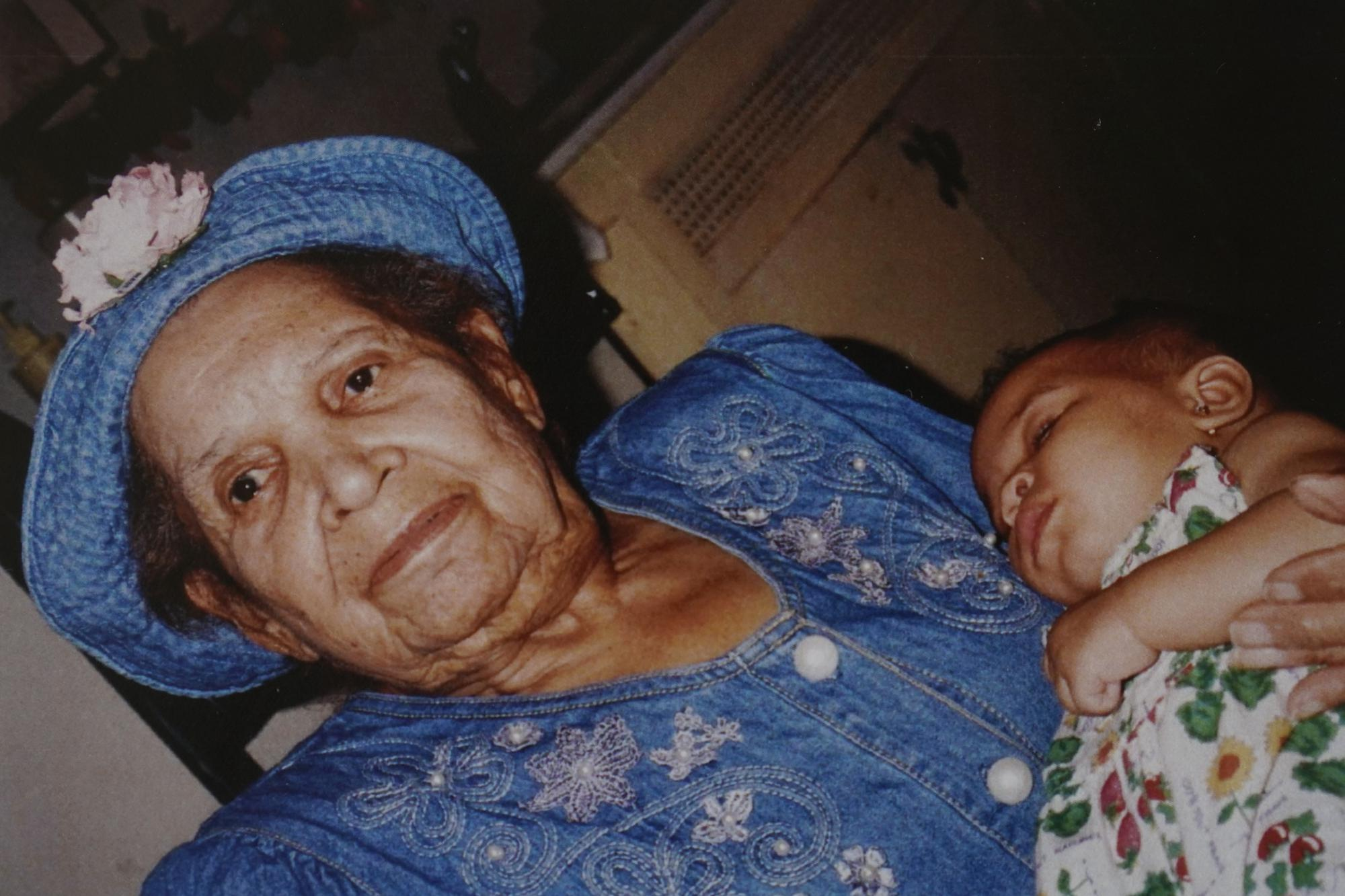 In this undated photo provided by Carolyn Roberts of the Gibbs family in April 2021, Tulsa Race Massacre survivor Ernestine Alpha Gibbs holds one of her grandchildren, DeShayla Roberts, two decades earlier. (Courtesy Carolyn Roberts via AP)