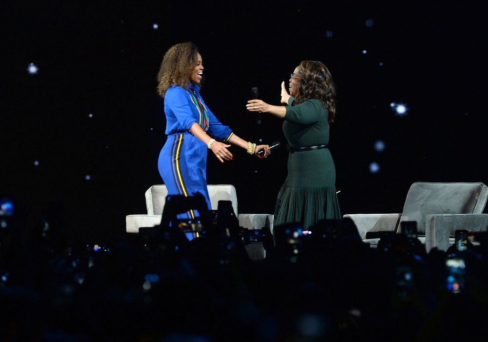 Michelle Obama, Oprah Winfrey headline arena like rock stars