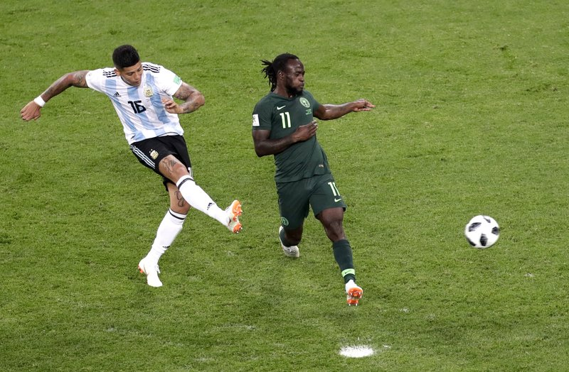 Argentina's Marcos Rojo, left, scores his side's second goal past Nigeria's Victor Moses during the group D match between Argentina and Nigeria, at the 2018 soccer World Cup in the St. Petersburg Stadium in St. Petersburg, Russia, Tuesday, June 26, 2018.