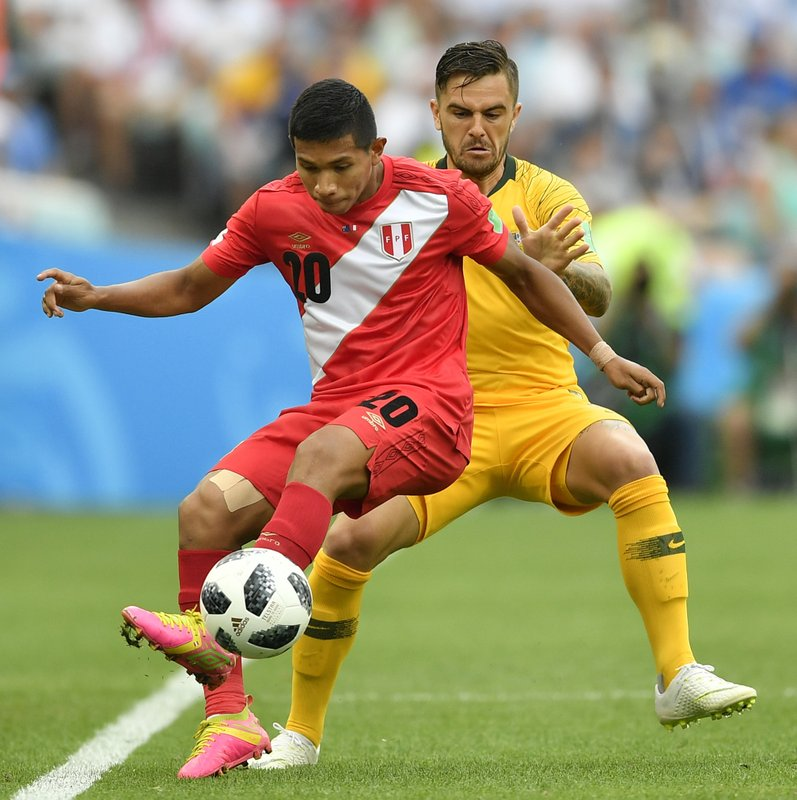Peru's Edison Flores, left, and Australia's Joshua Risdon challenge for the ball during the group C match between Australia and Peru, at the 2018 soccer World Cup in the Fisht Stadium in Sochi, Russia, Tuesday, June 26, 2018.
