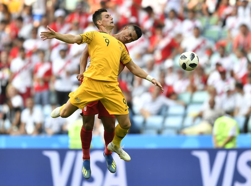 Peru's Anderson Santamaria, background, and Australia's Tomi Juric go for a header during the group C match between Australia and Peru, at the 2018 soccer World Cup in the Fisht Stadium in Sochi, Russia, Tuesday, June 26, 2018.