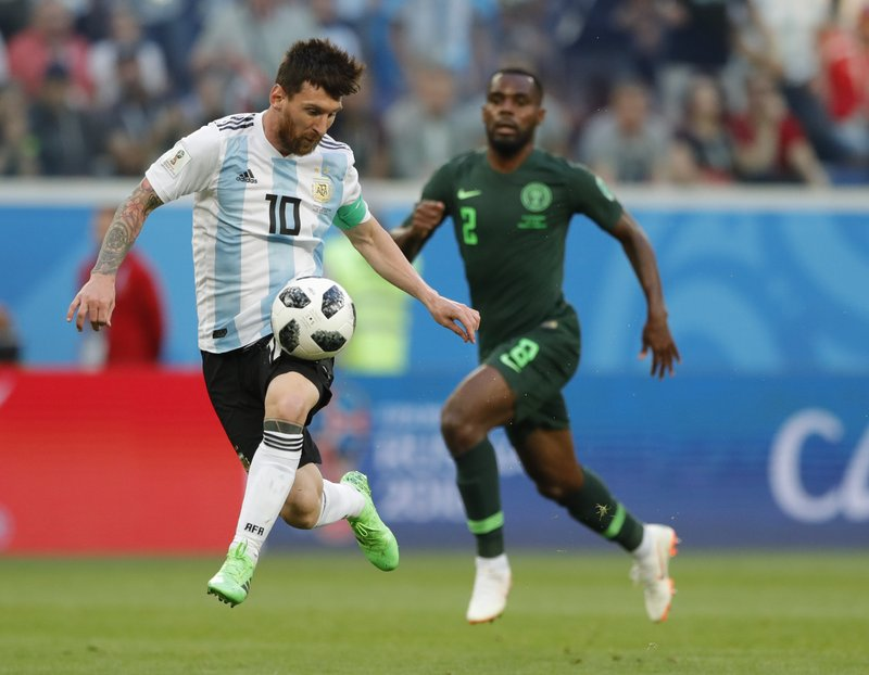 Argentina's Lionel Messi controls the ball during the group D match between Argentina and Nigeria, at the 2018 soccer World Cup in the St. Petersburg Stadium in St. Petersburg, Russia, Tuesday, June 26, 2018.