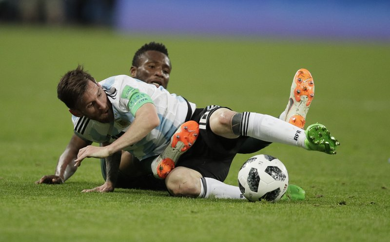 Argentina's Lionel Messi, foreground, and Nigeria's John Obi Mikel compete for the ball during the group D match between Argentina and Nigeria at the 2018 soccer World Cup in the St. Petersburg Stadium in St. Petersburg, Russia, Tuesday, June 26, 2018.