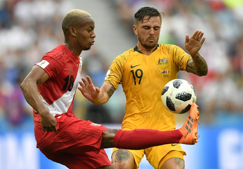 Peru's Andre Carrillo, left, and Australia's Joshua Risdon challenge for the ball during the group C match between Australia and Peru, at the 2018 soccer World Cup in the Fisht Stadium in Sochi, Russia, Tuesday, June 26, 2018.