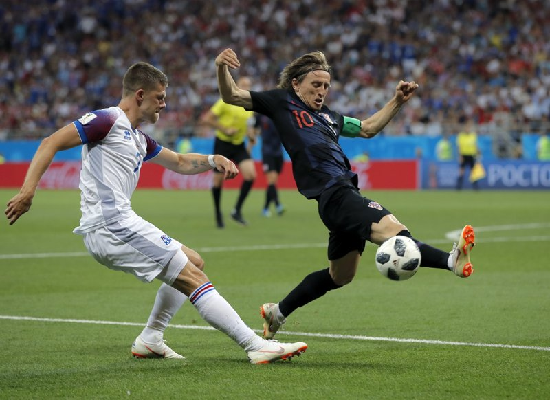 Croatia's Luka Modric, right, duels for the ball with Iceland's Johann Gudmundsson during the group D match between Iceland and Croatia, at the 2018 soccer World Cup in the Rostov Arena in Rostov-on-Don, Russia, Tuesday, June 26, 2018.