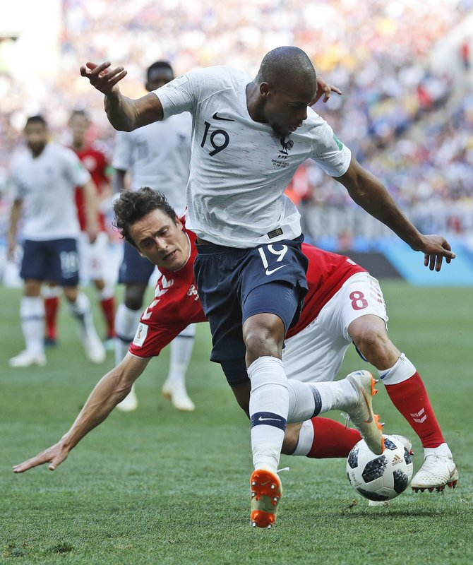 France's Djibril Sidibe, front, and Denmark's Thomas Delaney challenge for the ball during the group C match between Denmark and France at the 2018 soccer World Cup at the Luzhniki Stadium in Moscow, Russia, Tuesday, June 26, 2018.