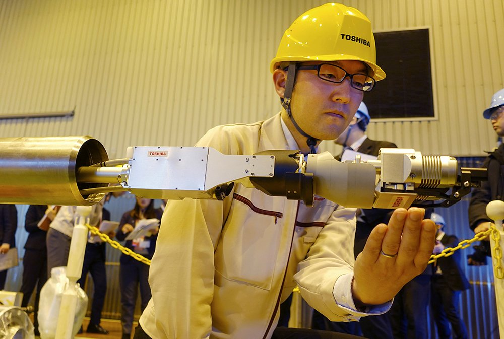 Toshiba unveils robot to probe melted Fukushima nuclear fuel