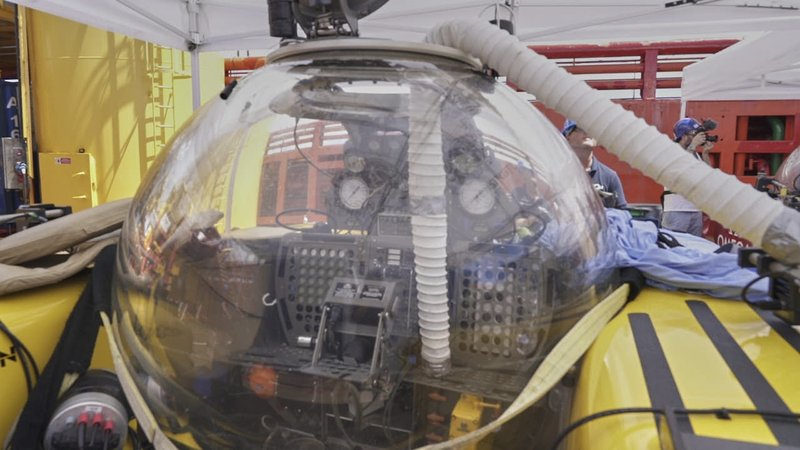 A submersible after British scientist and her American pilot had to make an emergency ascent from 250 meters beneath the surface of the Indian ocean off the Seychelles after smoke filled their two-person submersible, Tuesday March 19, 2019. The pair, from the UK-led Nekton Mission investigating climate change in the region, are both safe onboard the mother ship where an electrical fire aboard the sub is being investigated as the possible cause. (AP Photo/David Keyton)