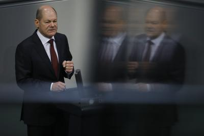 File - In this Tuesday, Dec. 8, 2020 file photo, German Finance Minister Olaf Scholz delivers his speech during the debate about Germany's budget 2021, at the parliament Bundestag in Berlin, Germany. The center-left Social Democrats' candidate to succeed German Chancellor Angela Merkel is backing the idea of a European Union army. But Olaf Scholz told weekly Frankfurter Allgemeine Sonntagszeitung that likely won't happen in the near term. (AP Photo/Markus Schreiber, file)