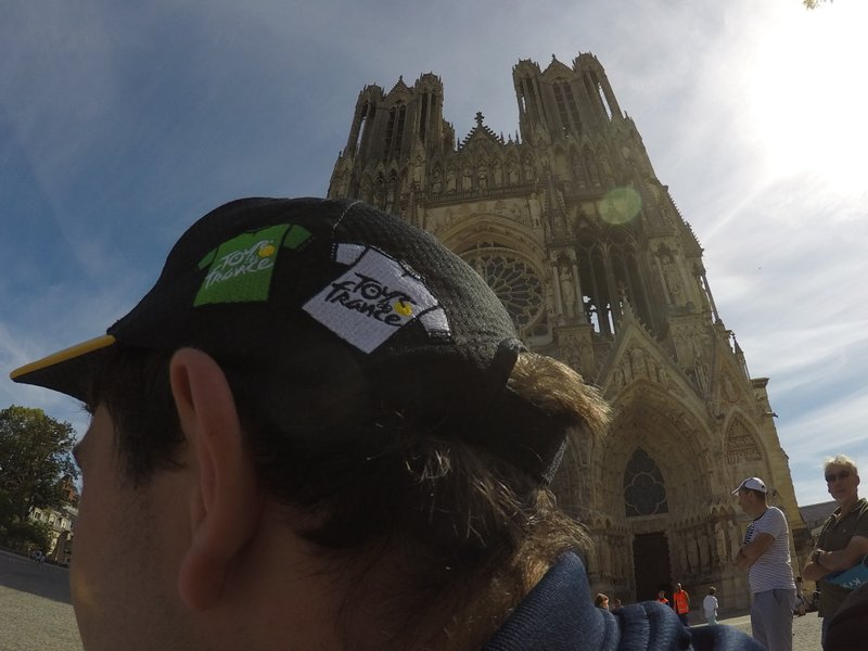 A spectator waits for the race in front of Reims' cathedral. (Credit: AP.)