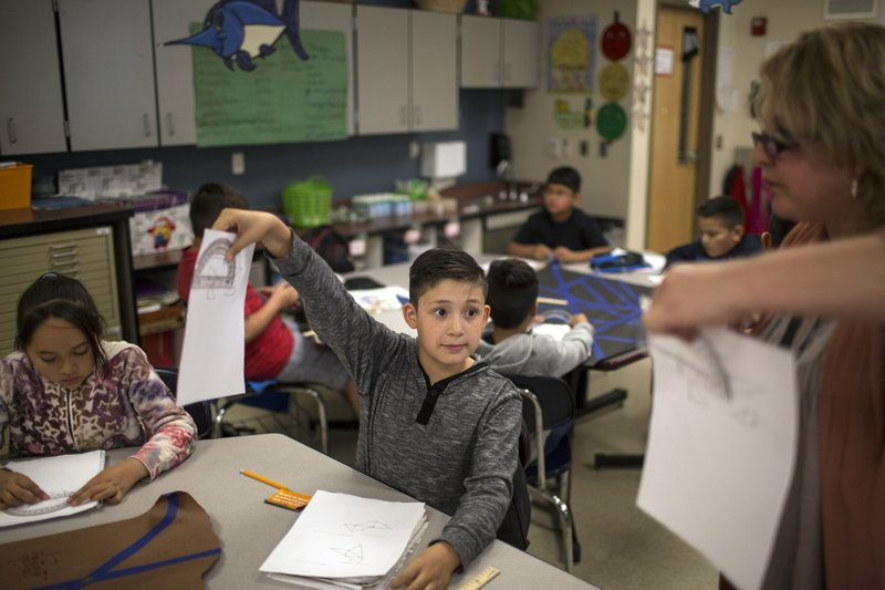 Student Shows His Geometry Work To A Teacher At Columbus Elementary School In New Mexico Friday March 31 2017 AP Photo Rodrigo Abd