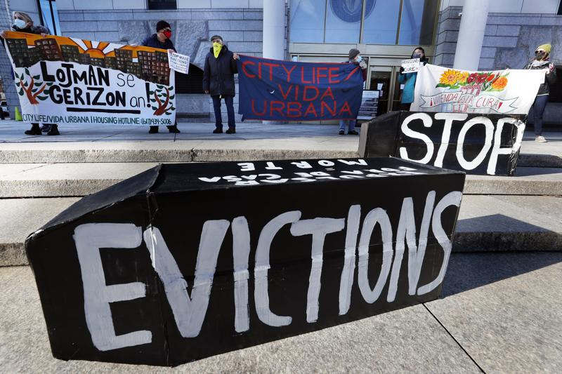 """FILE - In this Jan. 13, 2021, file photo, tenants' rights advocates demonstrate in front of the Edward W. Brooke Courthouse in Boston. A federal judge is refusing landlords' request to put the Biden administration's new eviction moratorium on hold, though she made clear she thinks it's illegal. U.S. District Judge Dabney Friedrich on Friday, Aug. 13, said her """"hands are tied"""" by an appellate ruling the last time courts considered the evictions moratorium in the spring. (AP Photo/Michael Dwyer, File)"""