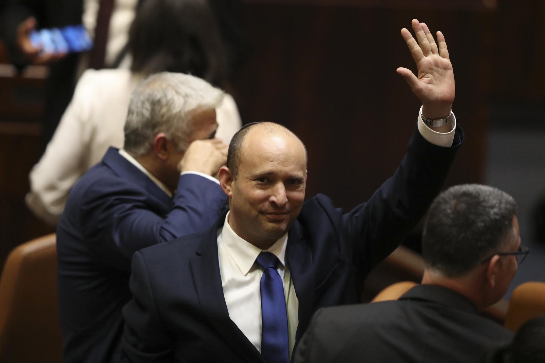Israel swears in new coalition  ending Netanyahu s long rule