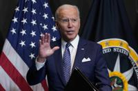 President Joe Biden finishes leaves after speaking during a visits to the Office of the Director of National Intelligence in McLean, Va., Tuesday, July 27, 2021. This is Biden's first visit to an agency of the U.S. intelligence community. (AP Photo/Susan Walsh)