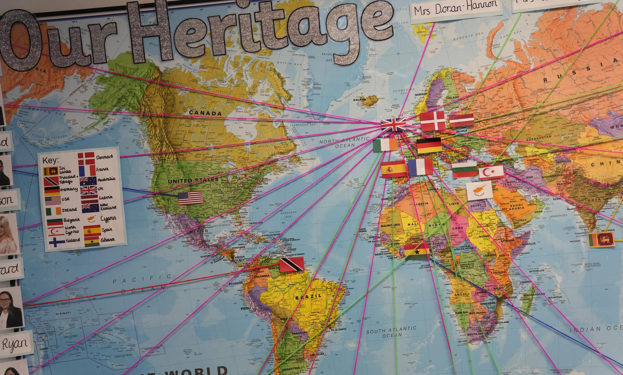 A world map showing the origins of members of staff at the Holy Family Catholic Primary School in Greenwich, London, Wednesday, May 19, 2021. Holy Family, like schools across Britain, is racing to offset the disruption caused by COVID-19, which has hit kids from low-income and ethnic minority families hardest. (AP Photo/Alastair Grant)