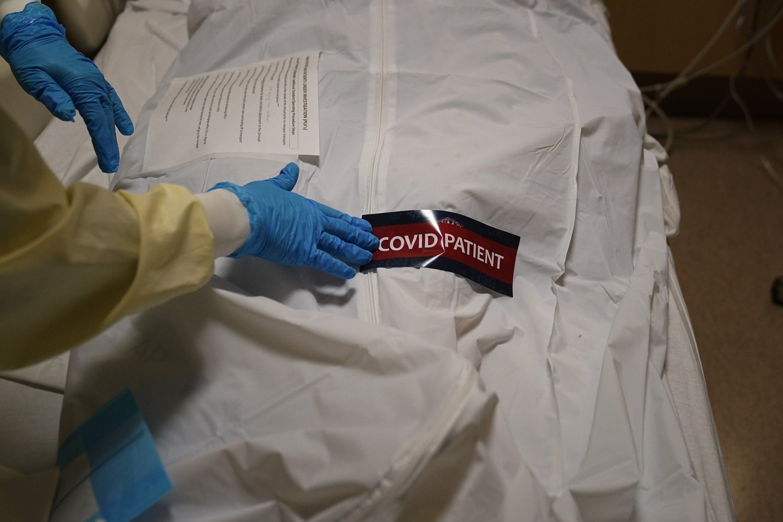 US virus deaths surpass 450K; daily toll is stubbornly high - Associated Press