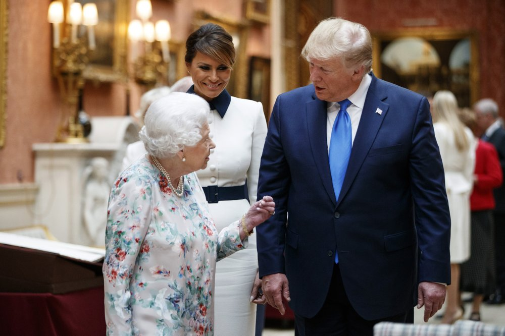 Britain's Queen Elizabeth II speaks to U.S President Donald Trump, right and first lady Melania as they view U.S memorabilia from the Royal Collection, at Buckingham Palace, London, Monday, June 3, 2019. Trump is on a three-day state visit to Britain. (Tolga Akmen/Pool Photo via AP)