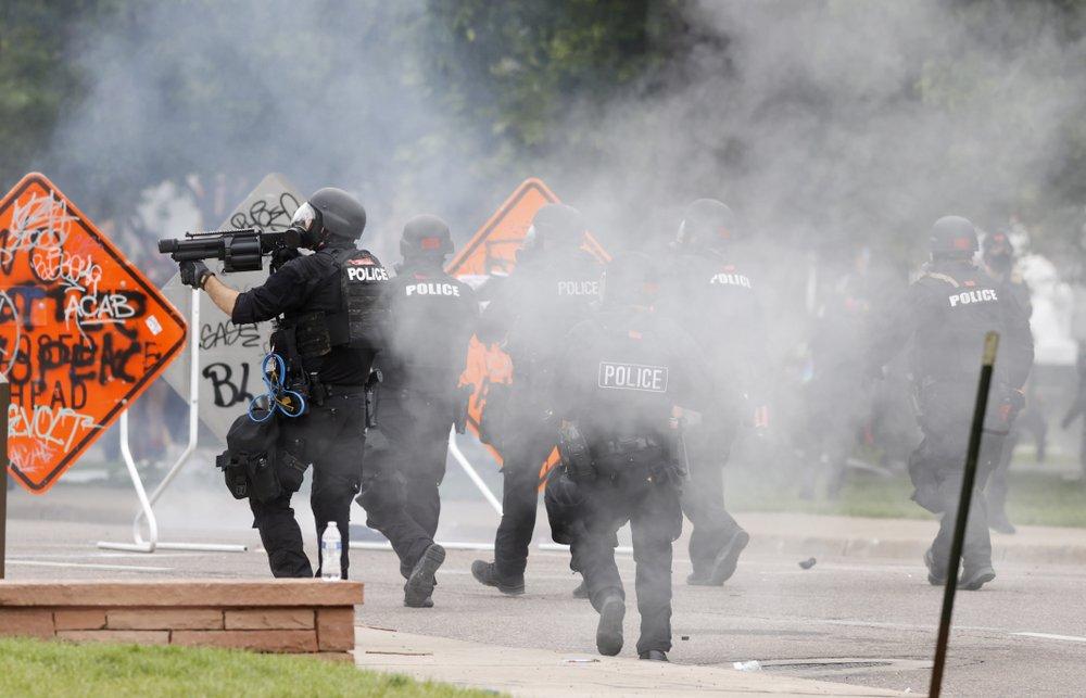 Police enforce night curfew using tear gas