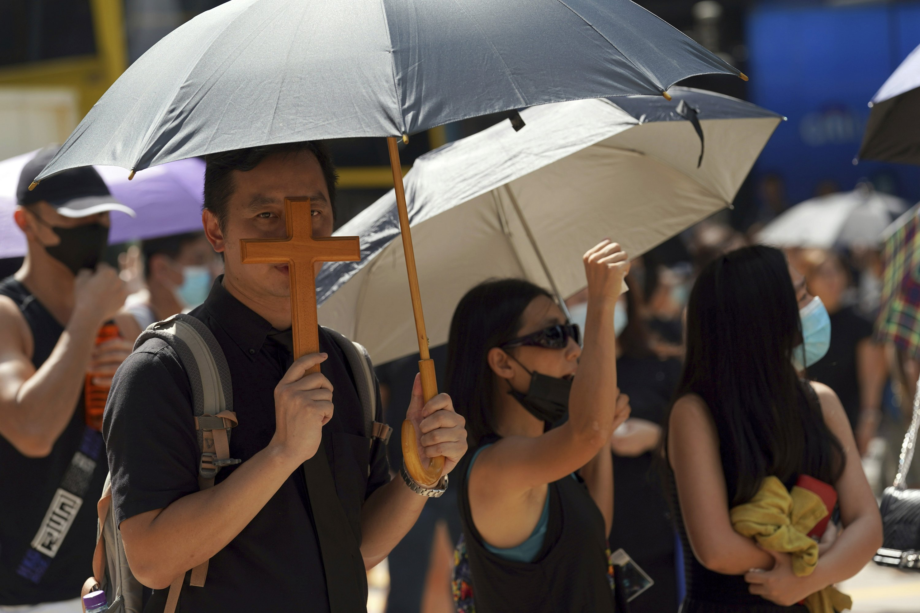 The Latest: HK protesters wear masks before ban takes effect